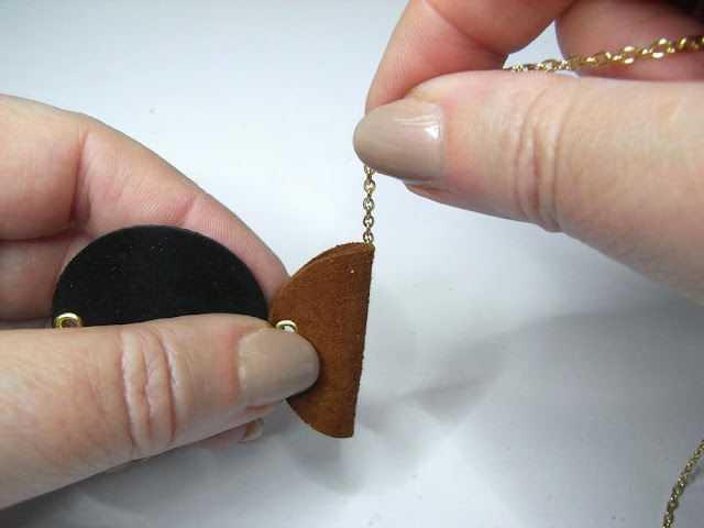 Feeding the necklace chain through the folded circle
