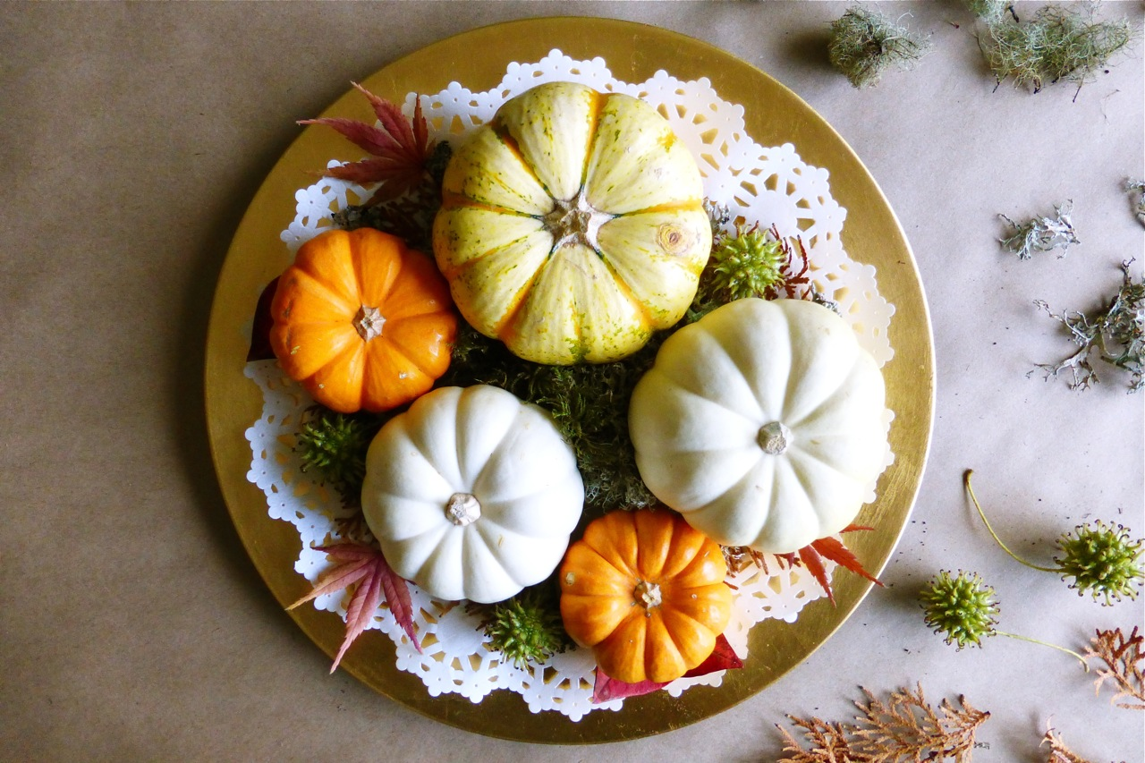 mini pumpkins, gold charger plate, doily, arborvitae springs, blueberry leaves, Japanese maple leaves, moss