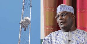 Man climbs mast in Abuja to protest against Atiku
