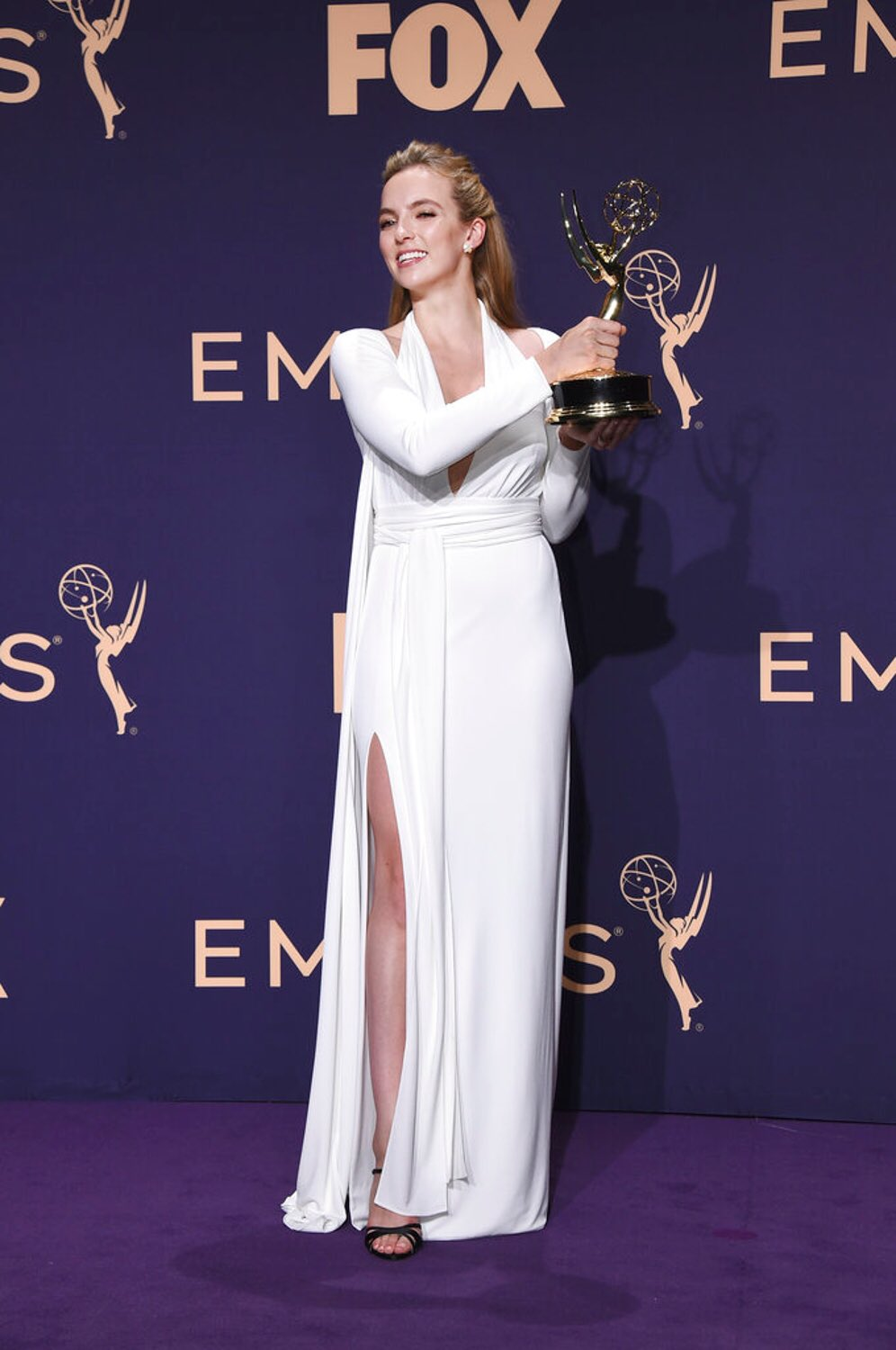 Jodie photographed with her award on the purple carpet after her #Emmys win