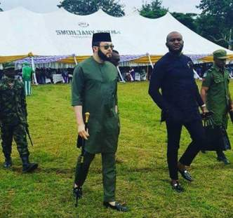 Viral photo of a former Abia Local Government Chairman, his Army bodyguards and man carrying his bag