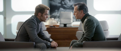 James T. Kirk (Chris Pine) and his mentor Christopher Pike (Bruce Greenwood) chat in Star Trek Into Darkness, in cinemas May 17