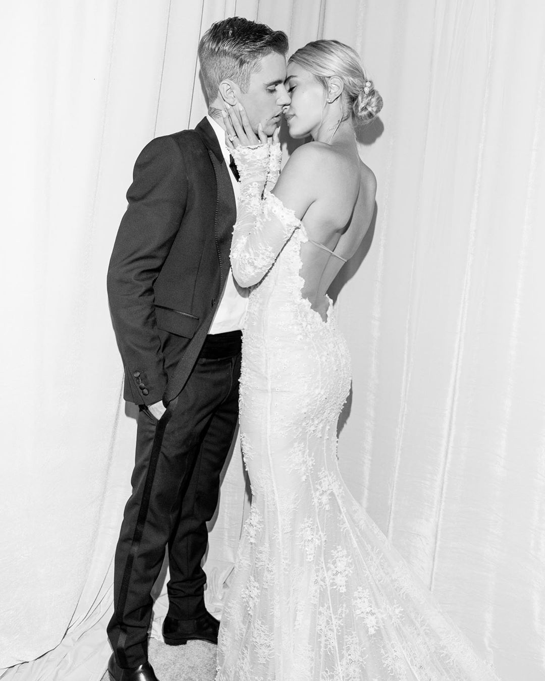 Hailey cupped her husband's face as the newlyweds shared a passionate kiss