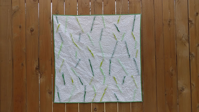 A spring inspired modern quilt using the Olfa chenille cutter