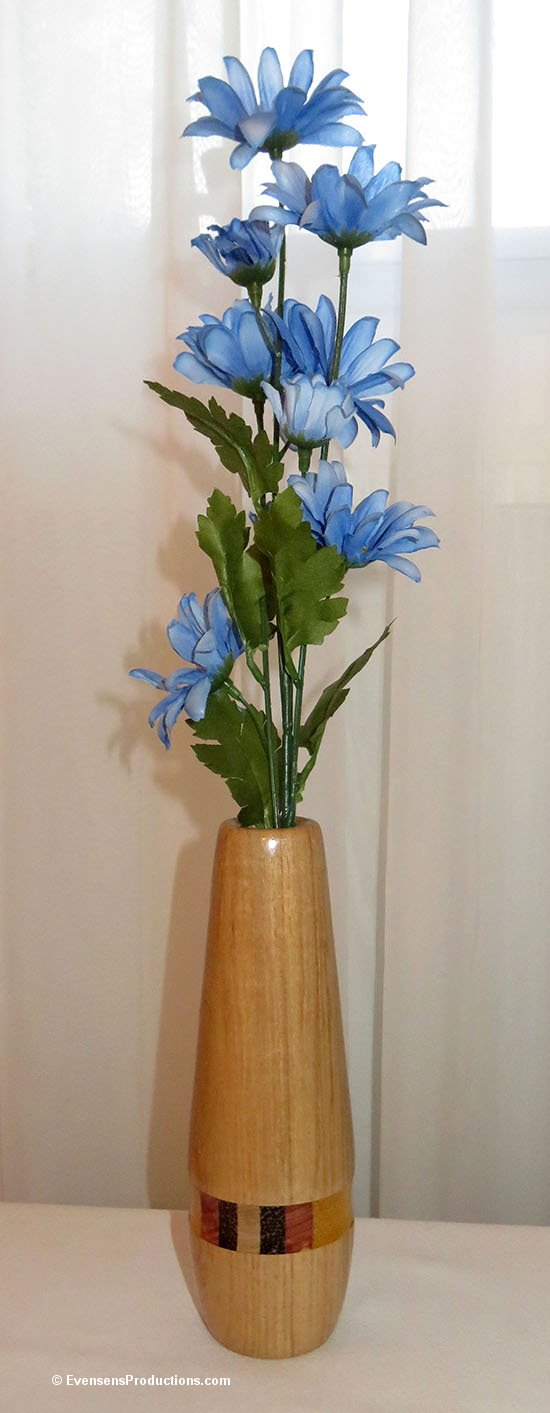https://www.etsy.com/evensensproductions/listing/570983615/vase-hand-turned-wood-and-glass-five?ref=shop_home_active_15