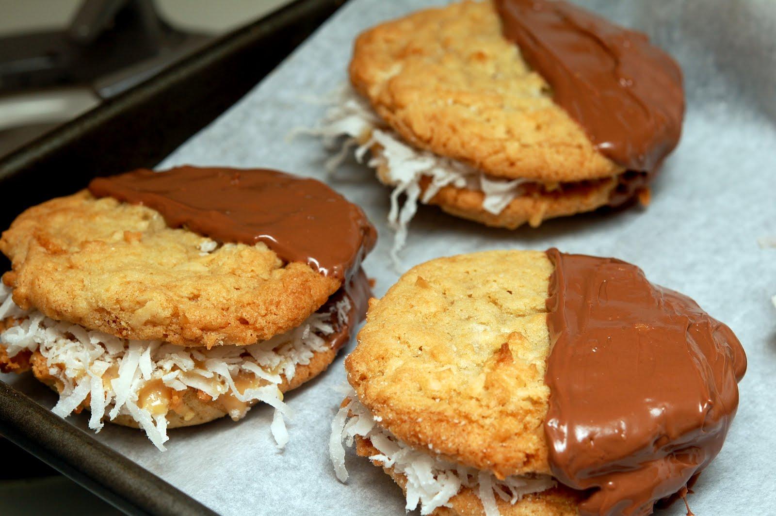 Dulce De Leche Stuffed Coconut Cookies Dipped In Milk