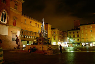 Piazza Maggiore, pictured here at night, is the beating heart of the city of Bologna