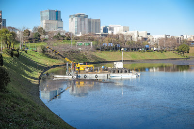 Sakurada Moat, Imperial Palace, Tokyo, Japan, plus barge doing repair work.
