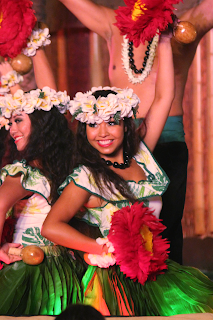 Woman performs at luau.