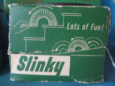 Green and white Slinky box, 1950s design style