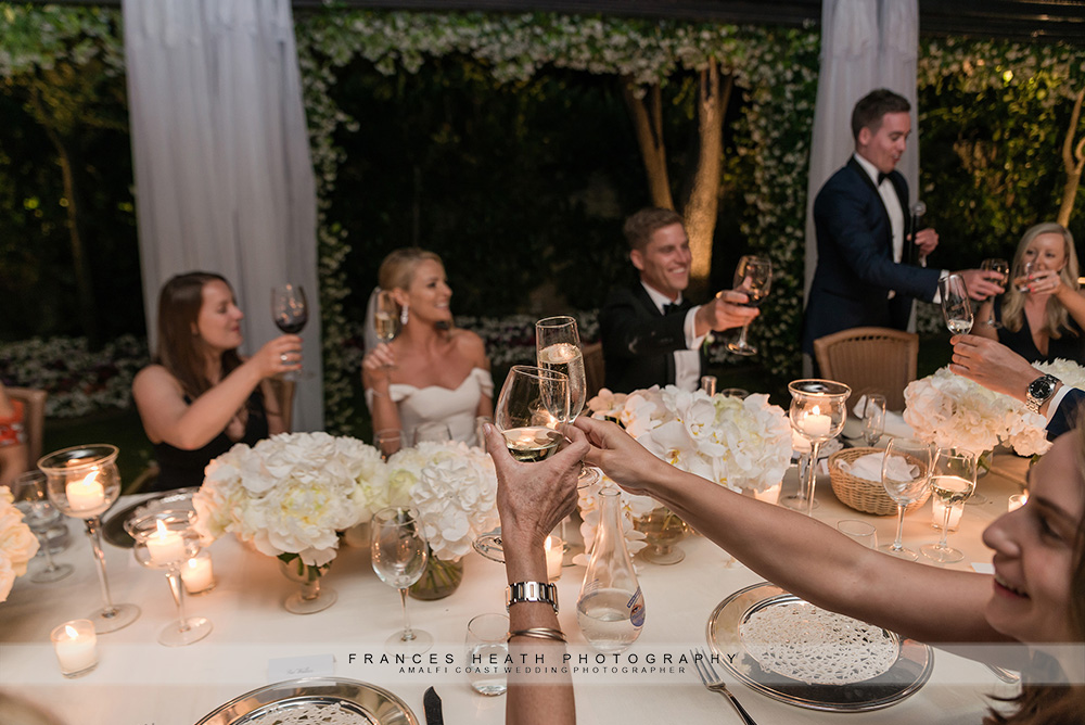 Guests toasting during wedding speech