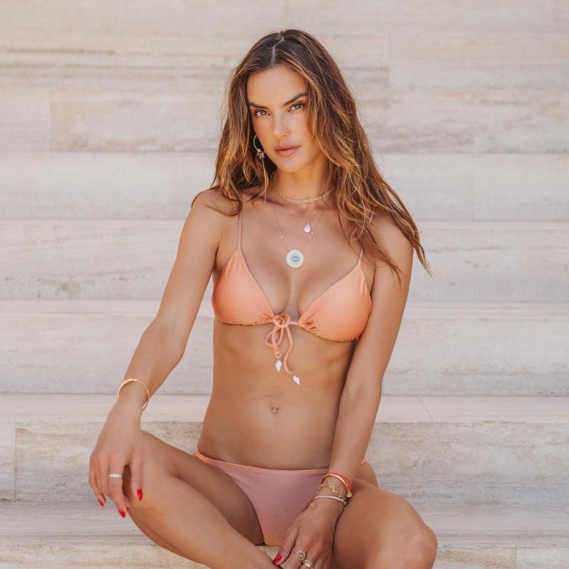 Alessandra Ambrosio models Gal Floripa Ethereal bikini top and bottom in Rosé.