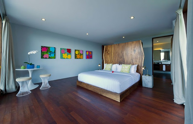 Picture of large wooden bed in another bedroom in the cliff villa