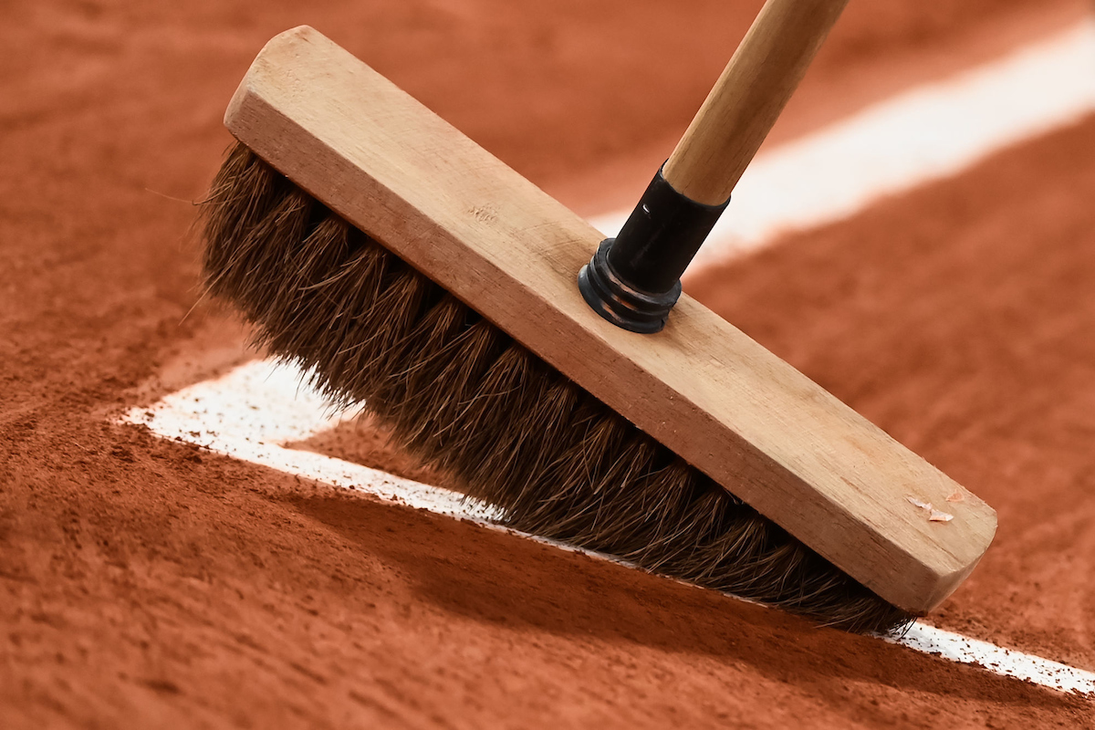 Broom sweeps clay