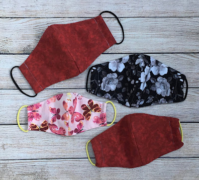 Face masks sewn from cotton fabric according to the Olson patter