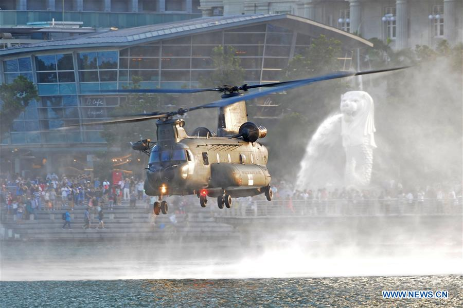 A CH-47 chinook helicopter of the Republic of Singapore Air Force flies low in an aerial display during the first national day parade rehearsal held in Singapore's Marina Bay on June 24, 2017.