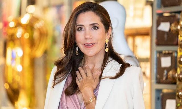 Crown Princess Mary wore a flared drape print silk dress by Prada. Gold earrings, Cartier love diamond gold bracelet, suede pink pumps