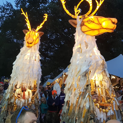 Just So Festival 2019 Lantern Parade giant stags made from sticks and paper and lit from inside by tealights and fairy lights