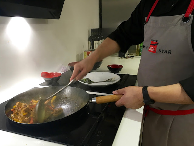 Stir frying at The School of Wok