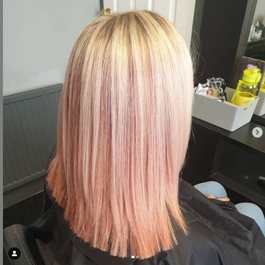 Freshly cut blonde hair with pink underneath
