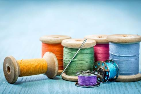 Image showing colorful sewing threads placed on a table