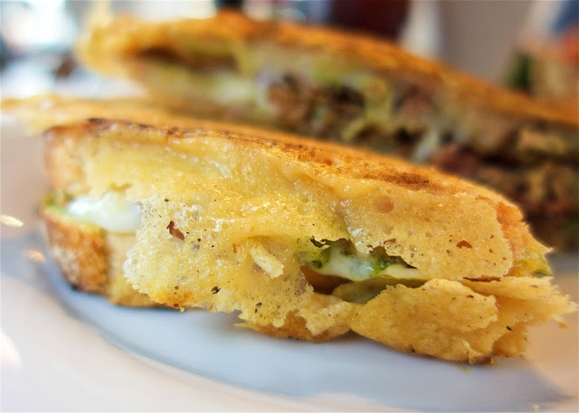 Parmesan Crusted Grilled Cheese - mozzarella, tomatoes, pesto and pulled pork. THE BEST grilled cheese I've ever eaten. You MUST eat here if you are in the Destin/30A area!