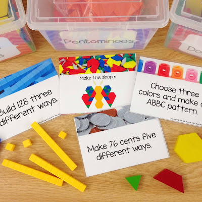 Photo of math morning work task cards with a variety of math manipulatives and bins.