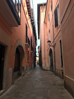 pink buildings on a narrow street in palma