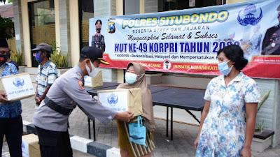 Memperingati Hari Korpri Ke- 49, ASN Polres Situbondo Bagikan Sembako