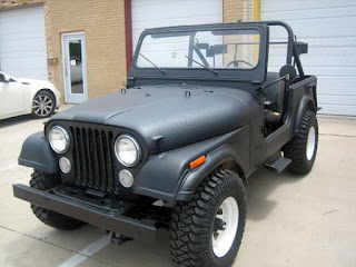 Old Jeep painted with bedliner
