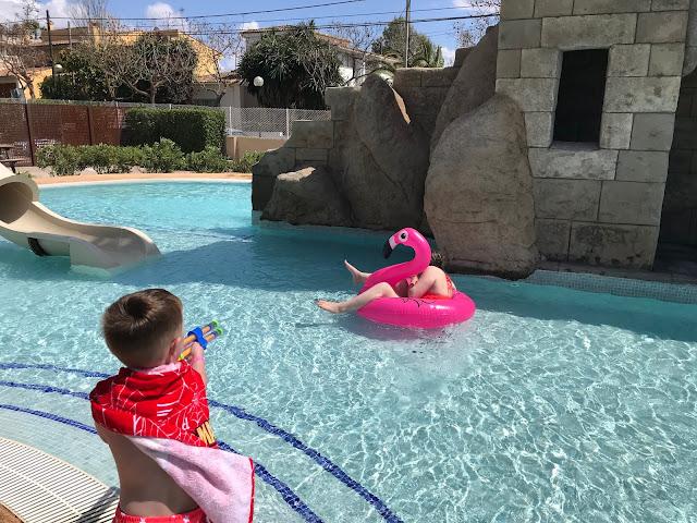 playing in the splash pool at Pirates Village Majorca