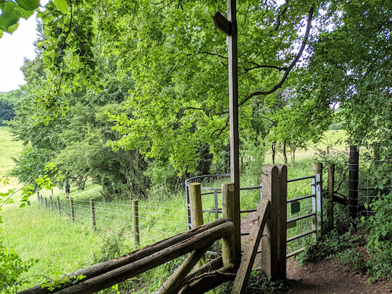 The charming Great Gaddesden footpath 4 leaving Hoo Wood