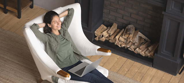 Person relaxing with laptop