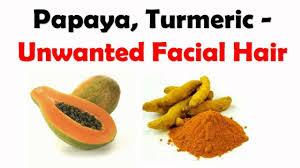 papaya and turmeric is the best face pack to remove unwanted hair on face