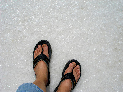 Feet standing on salt bed, Inagua, Bahamas.