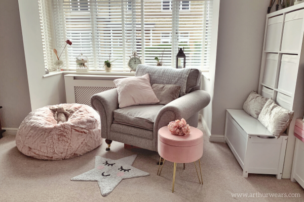Dusky blush rose pink and grey lounge sitting room with pink ottoman stool and beanbag
