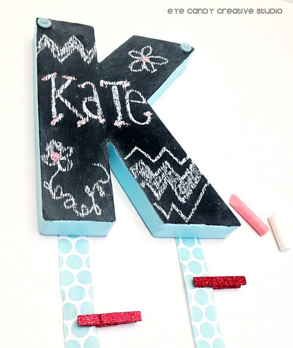 embellishments, buttons, glue gun, chalkboard initial, chalk, ribbon