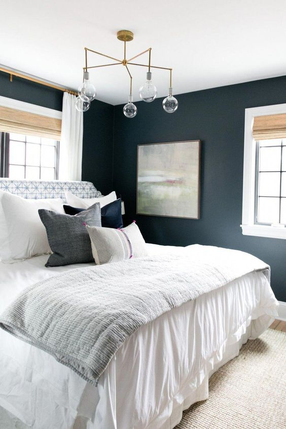 Dark blue painted bedroom walls