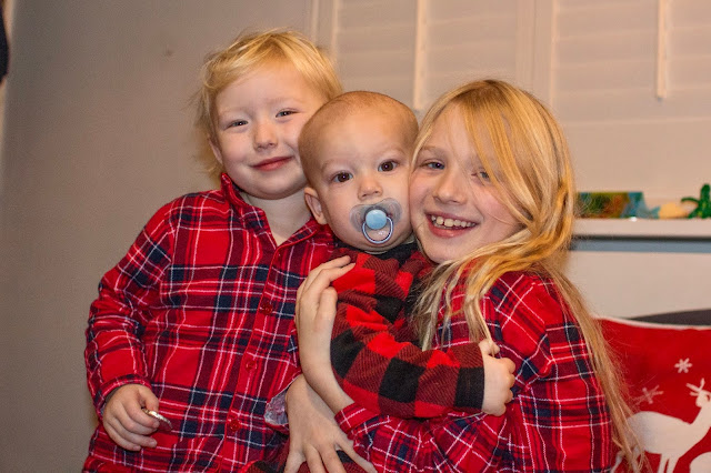 My 3 children in christmas pyjamas