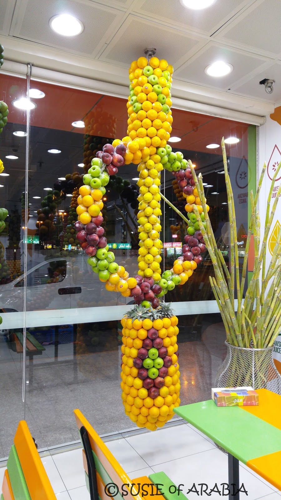 Hundreds of fresh fruits are formed together into a variety of shapes and geometric designs to create a delightful and appealing display