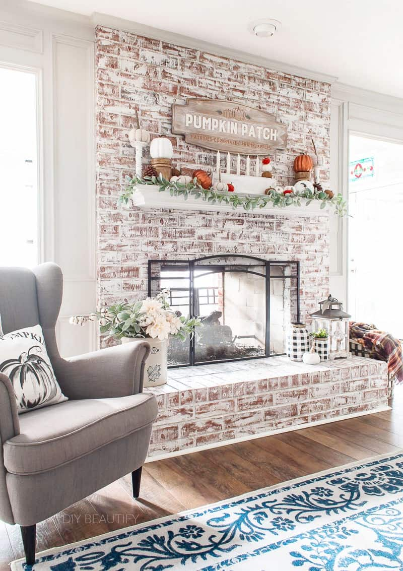 painted fireplace decorated for Fall