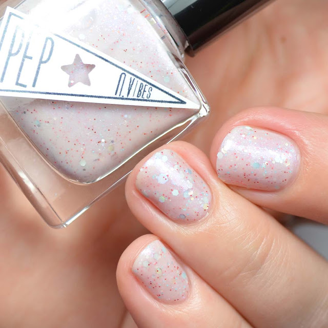 off white nail polish with pink shimmer and glitter