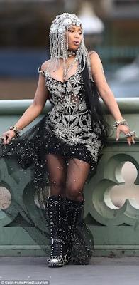 BTS pics of Nicki Minaj wearing a rhinestone corset for her video shoot in London