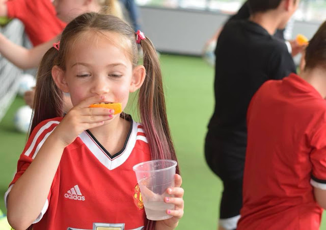 girl Eating oranges at half time