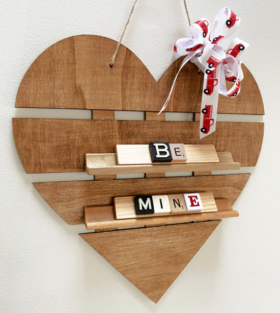 Stained heart sign with Be Mine letters