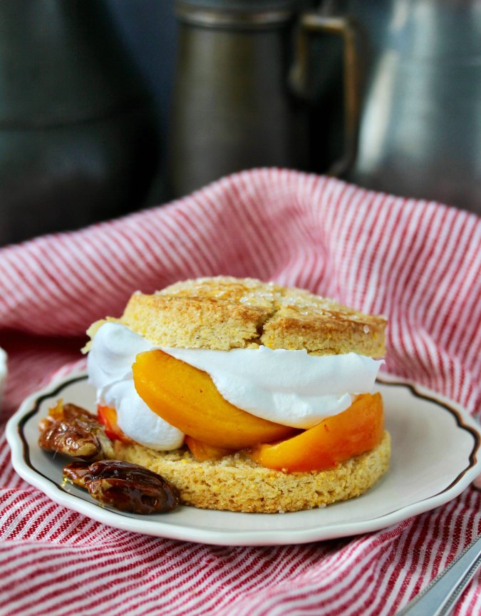 Peach Cornmeal Shortcakes with Candied Pecans and whipped cream