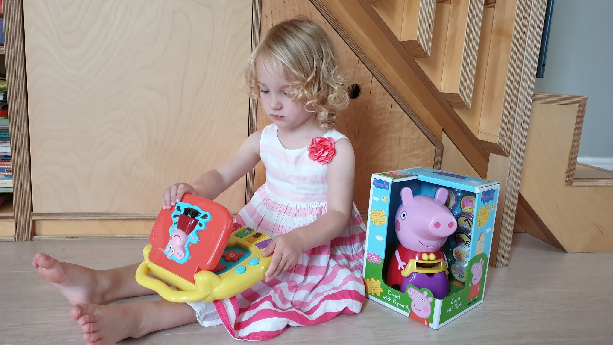 girl playing with peppa pig laptop