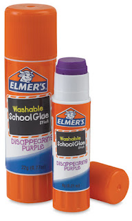 This is a photograph of two glue sticks.