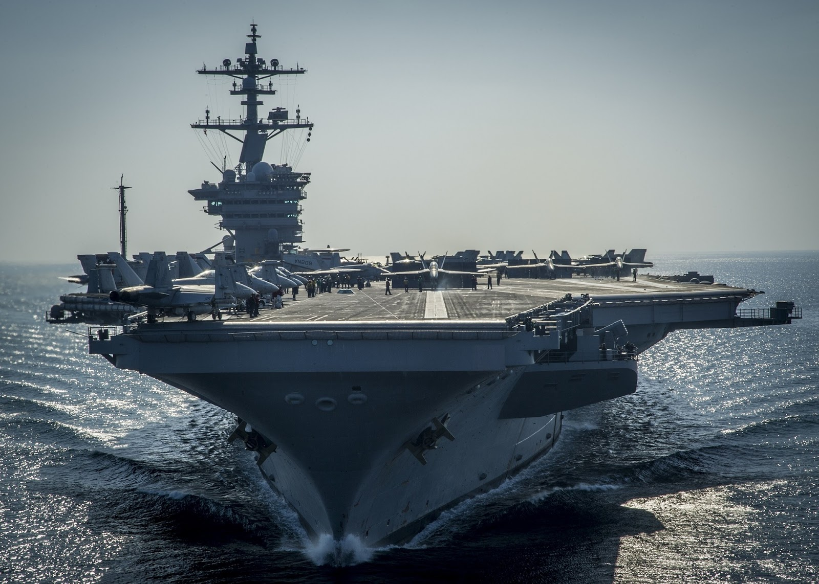 giant military aircraft carrier sailing on calm seas to illustrate movies about the U.S. navy