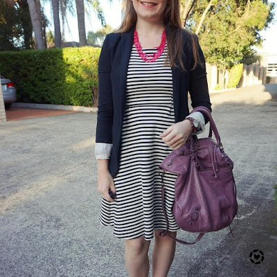 awayfromblue Instagram black and white striped dress blazer outfit pink necklace purple balenciaga pompon bag